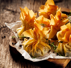 Filo pastry stuffed with spinach and feta cheese,  delicious vegetarian phyllo purses