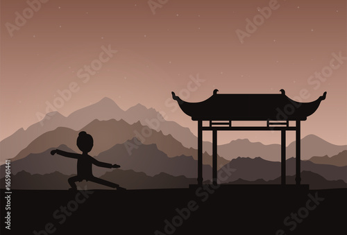 Girl performing qigong or taijiquan exercises in the evening