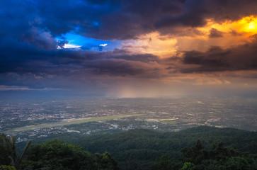 Thunderstorm with rain on sunset.