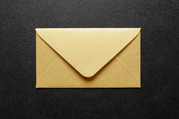 gold envelope on black background