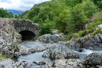 Water under the bridge gentle stream stone old