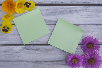 A note on a wooden surface framed by summer flowers 7