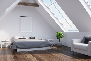 Attic bedroom with a gray bed, poster, side