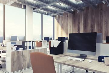 Wooden open office, computers closeup, black