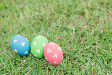 Colorful easter eggs on green grass