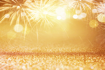 Fototapete - Holiday Gold Fireworks and bokeh in New Year eve and copy space. Abstract background celebration.