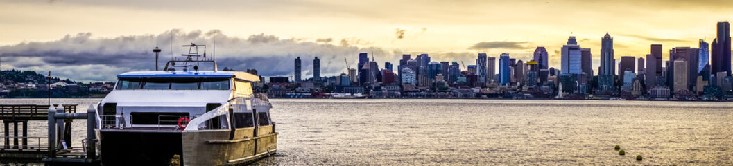 seattle city skyline early morning with watercraft in foreground