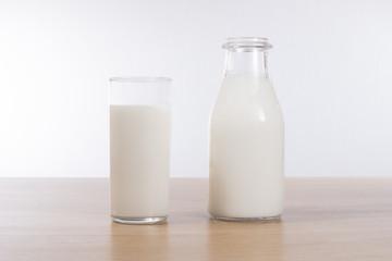 Glass bottle full of fresh healthy milk