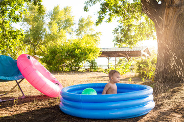 boy swim in inflatable pool