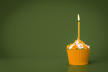 orange cupcake with a candle