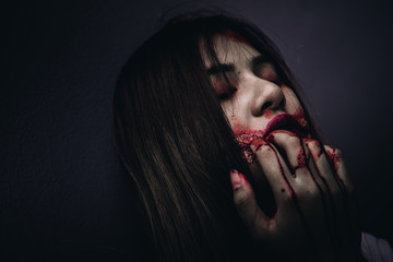 Zombie women death ghost eating with blood, darkness background, horror halloween festival concept