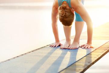 Woman practicing morning yoga