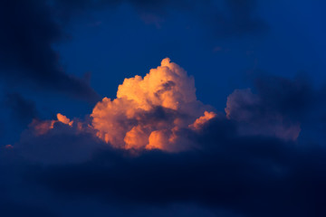 natural background of sky with clouds illuminated by the last sun rays at sunset