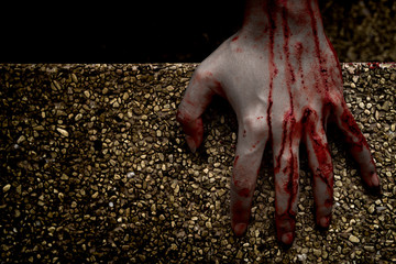 Hand zombie death with blood touching stair on nightmare darkness background, horror halloween festival concept
