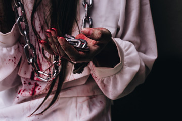 Zombie women death  ghost standing with blood and chain, darkness background, horror halloween festival concept