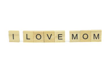 Text wooden blocks spelling the word i love mom on white background
