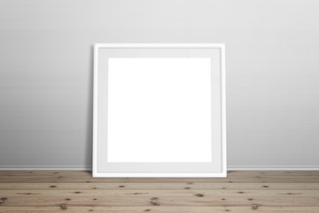 White picture frame mockup. Isolated frame for art, design presentation. Frame leaning on white wall. Wooden floor.
