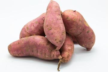 Purple fressh sweet potato on white background