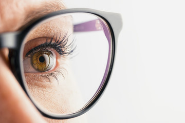 Businesswoman eye with glasses close-up