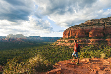 Travel in Sedona, man Hiker with backpack enjoying view, USA