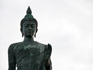 Phra Sri Sakyamasamuthi is a big buddha statue in Phutthamonthon Nakhon Pathom Thailand on sunset with clouds