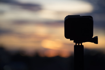 Silhouette Action camera in front of the twilight sky