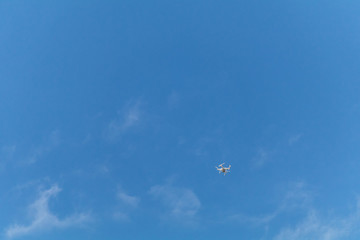 Drone flying in the blue sky