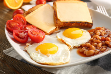 Tasty breakfast with fried eggs, closeup