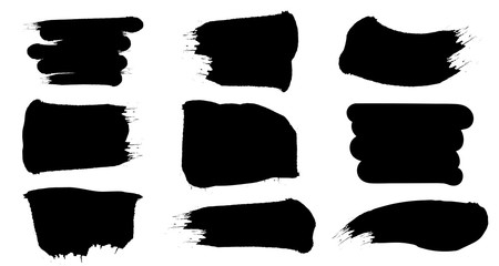 Black paint brush spots. Abstract shape grunge stains set. Vector