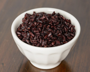 Cooked black rice in bowl