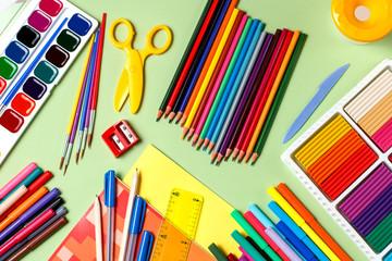 School background. Various school supplies on a desktop, copy space