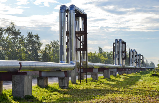 Overground heat pipes. Pipeline above the earth conducting heat for heating city