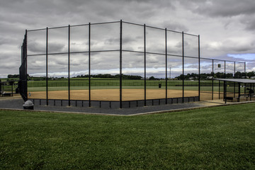 vacant baseball field before a storm