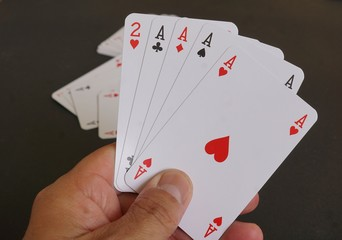 Aces poker cards in hand