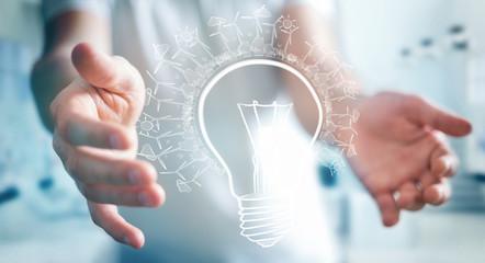 Businessman holding renewable eco lightbulb sketch