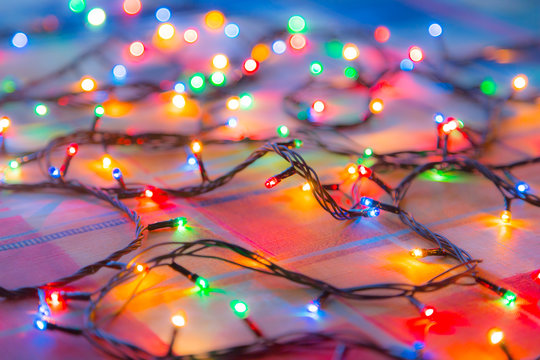 Colored lights Christmas garlands. Colorful abstract background. Blur and bokeh