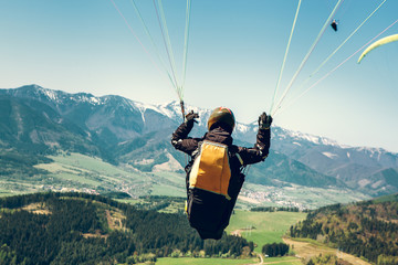 Foto auf Acrylglas Luftsport Paraglider is on the paraplane strops - soaring flight moment