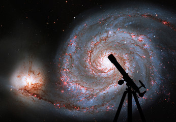 Space background with silhouette of telescope. Whirlpool Galaxy. Spiral galaxy M51 or NGC 5194.