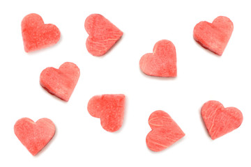 Carved from watermelon slices in shape of hearts on white background