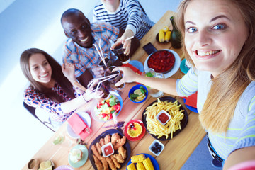 Group of people doing selfie during lunch. Self. Friends. Friends are photographed for eating