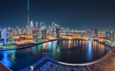 Dubai Business Bay at night with beautiful Towers and colorful reflections at night