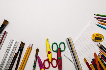 Elementary school supplies stationery on white background