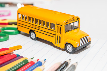 Yellow school bus toy with schools stationery supplies