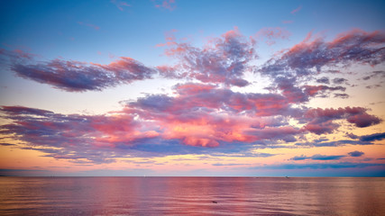 Pink cloudy sunset Lake Superior