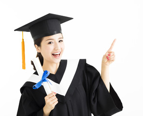 Happy  graduation showing diploma and pointing gesture