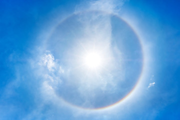Looking up at Sun halo with circular rainbow at clear sky,natural phenomena