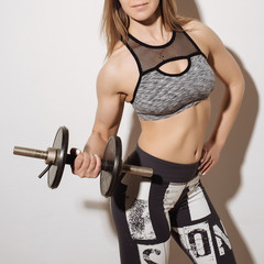 Perfect Fitness Body of Beautiful Woman. Fitness Instructor in Sports Clothing.