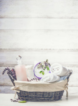 Basket with spa ,wellness or beauty setting on white wooden background, front view