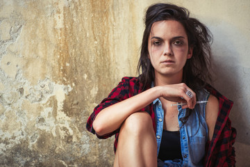 Dependence on drug heroin young woman after having pierced with syringe