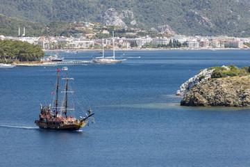 Turistic sail boat stylized as a pirate shipin the calm bay near Marmaris, Turkey